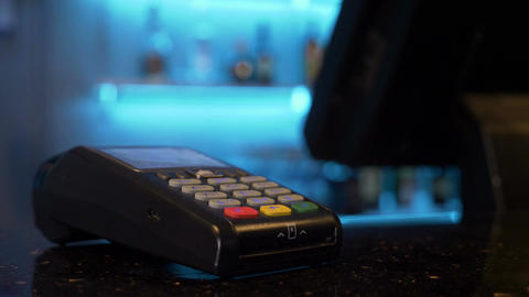 Customer using credit card over pos module for cashless contactless payment for Footage