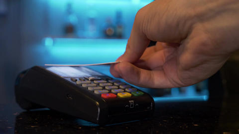 Paying using contactless credit card Stock Video Footage
