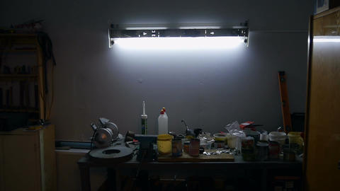 Light turns on above the workbench Footage