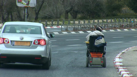 wheelchair rides on the highway Stock Video Footage