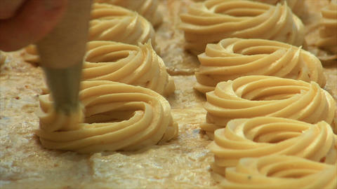 german bakery squirt dough on sheet 10747 Stock Video Footage