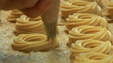 german bakery squirt dough on sheet 10747 Footage