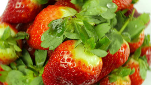 Top-down View of Rotating Strawberries on White Background Footage