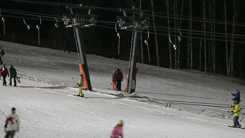 Skiers and snowboarders on a ski lift Footage