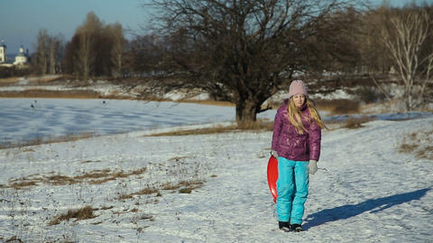 Girl with a sledge walks in winter Park Footage