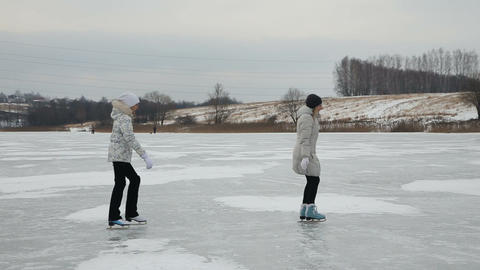 Family ice skating on frozen lake Footage