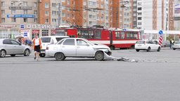 Side view of damaged car, stand on lively road intersection, front bumper fall Footage