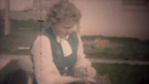 1949: Kids playing with baby bunny rabbits with mother supervision Footage
