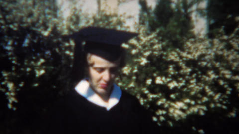1949: College graduate in classic black and white gown and cap Footage