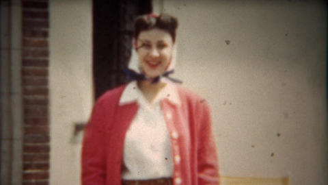 1942: Pretty women with 40's pink cardigan sweater and hair curled Footage