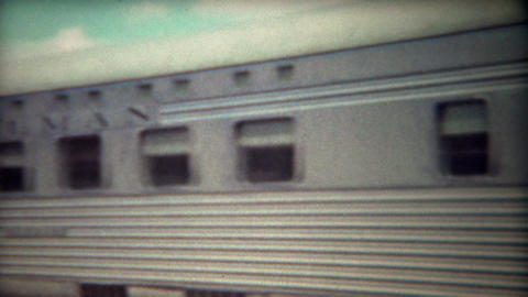 1947: Woman smoking outside Pullman railroad train before entering Footage