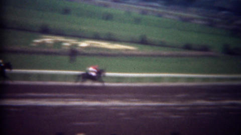 1948: Horse has big lead at racing track on wet muddy day Footage