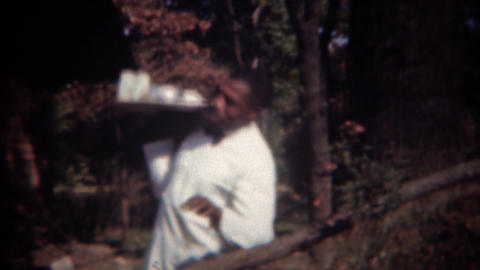 1944: African waiter chef serving fancy food tray to wealthy patrons Footage