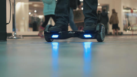 Hoverboard with Blue LED Lights Rolling Around Footage