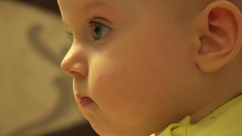 Closeup of Interested Baby Girl Face. 4K UltraHD, UHD Footage