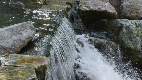 Water flows down from the falls to stones Footage