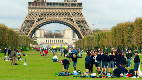 PARIS, FRANCE - OCTOBER 7, 2017. Crowded Champ de Mars lawn near the Eiffel Footage