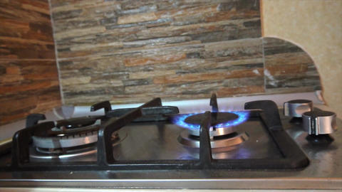 Turning On and Off a Stove Burner Footage