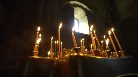 Taper Candles Burning in Church Image