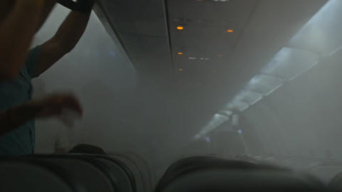 Girl and Guy Take Seats in Airplane Passenger Cabin with Mist Footage