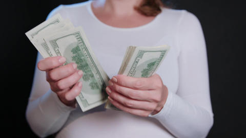 A Woman in White Sweater Holding Cash Footage