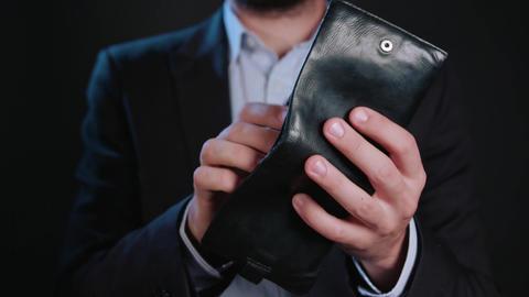 A Businessman Hiding Cash in His Wallet Footage