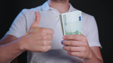 A Man in White T-Shirt Holding Cash Footage
