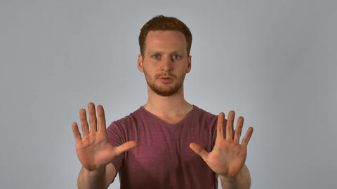 redheaded male shows sign that's enough Footage