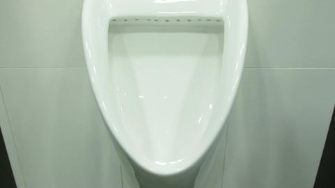 A Uinal in Men's Public Toilet Footage