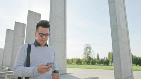 A Young Man Using a Phone Outside Filmmaterial