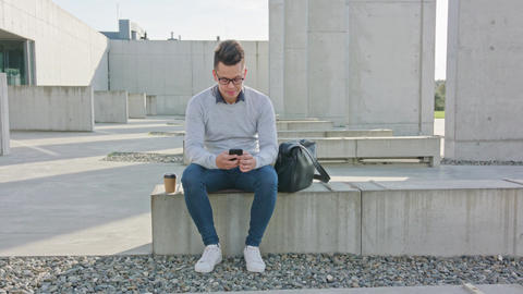 A Young Man Using a Phone Outside Footage