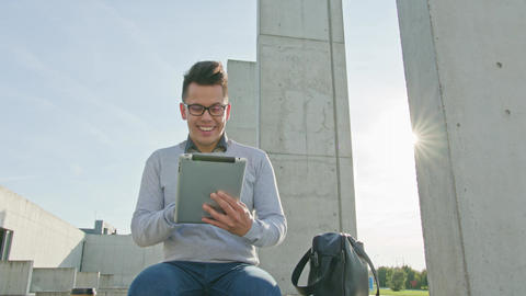 A Young Man Using a Tablet Outside Footage