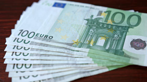 Fanned Pile of Hundred Euro Banknotes on a Table Footage