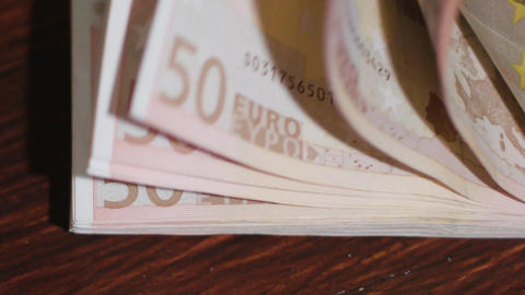 Pile of Fifty Euro Banknotes on a Table Footage