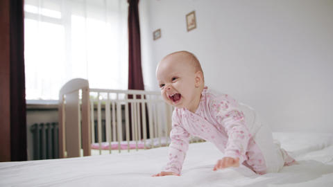 Baby Crawling on All Fours on the Bed Footage