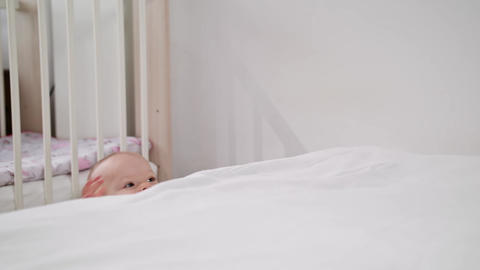 Baby Standing near the bed at Home Footage
