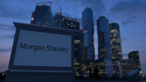 Street signage board with Morgan Stanley Inc. logo in the evening. Blurre Footage