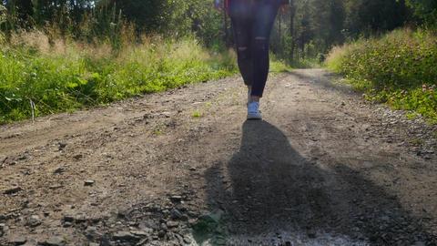 Girl walks along the path Footage