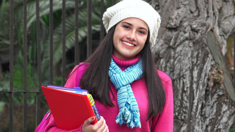 Smiling Female Teen Student Wearing Sweater Cold Weather Live Action