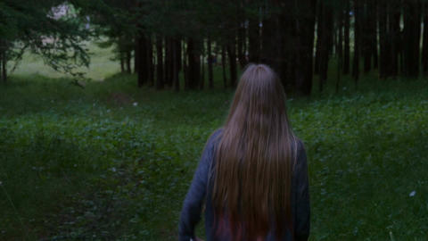 Girl walk down the path Footage