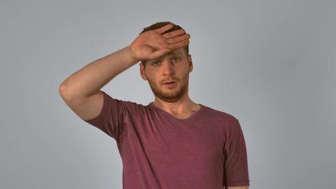 redhead male shows feeling fatigue Footage
