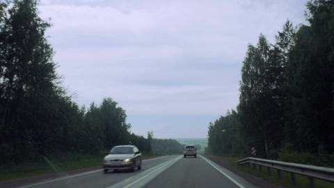 Cars are driving along the road Footage