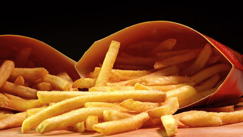 Paper boxes with french fries. Popular fast food deep... Stock Video Footage