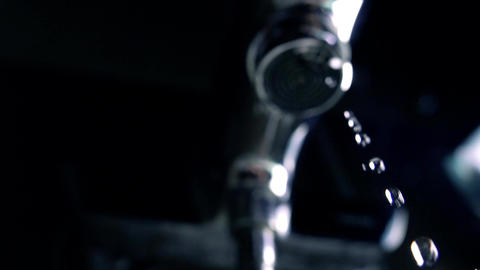 Dripping faucet. Loosing concept. Super slow motion extreme close up shot Footage