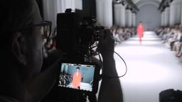 Press zone on fashion show. Cameraman at work Footage