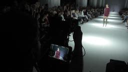 TV press at fashion show. Cameraman at work on the catwalk Footage
