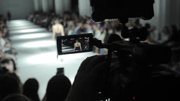 Press. TV. Camera cameraman shoots fashion show Footage