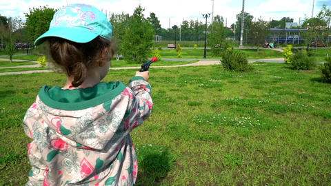 a little girl with a toy gun Footage