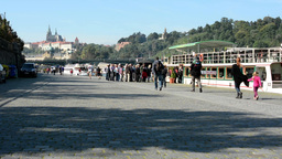 boats on the river in quay (Vltava) - people get on - city (Prague Castle - Hrad Footage