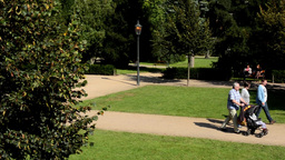 park - green nature (trees and grass) - street lamps - pathway and benchs - peop Footage